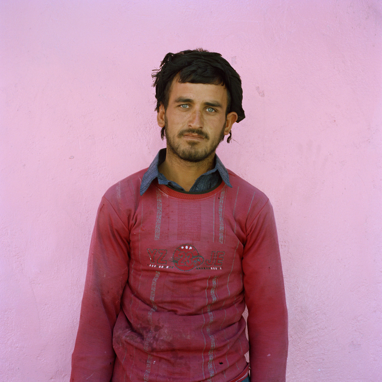 Afghan man pink wall